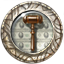 File:Badge DayJob Auctioneer.png